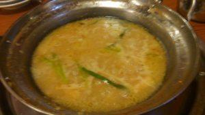もつ真路のもつ鍋のスープで締めの雑炊1