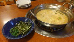 もつ真路のもつ鍋のスープで締めの雑炊2